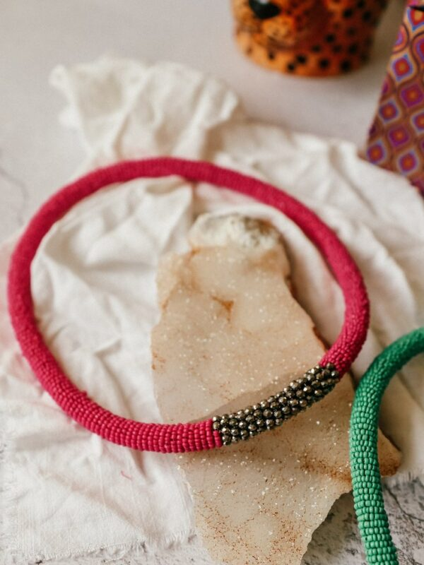 This bold and beautiful hand beaded necklace in adelicatepink tone. With a touch of metallic pewter detail.